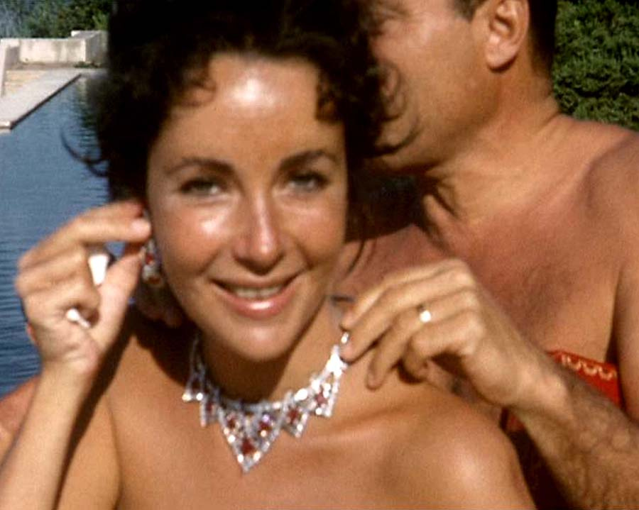 Elizabeth taylor and Mike Todd by the pool with rubies and diamonds