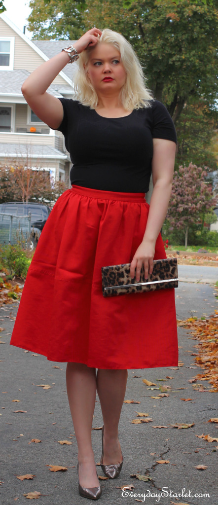 red 50s skirt red lips leopard clutch metalic pumps messay hair