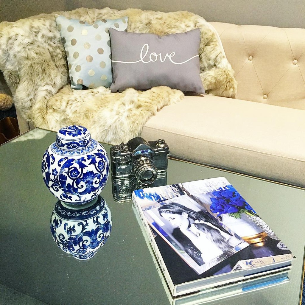 I did the @jossandmain white sofa challenge...leopard print, a camera, and a beauty book= Me #hearthome